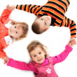 Three children lying — Stock Photo