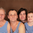 Four generations in frocks — Stock Photo