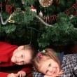 Two children under christmas tree — Stock Photo