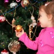 Little girl and christmas fir — Stock Photo