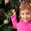Stock Photo: Little girl and christmas fir 2