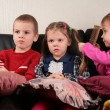 Three children on sofa watching tv — Foto Stock