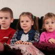 Three children on sofa 2 watching tv — Stock Photo #7439973