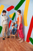 Children help parents to do repair room, collage — Foto de Stock