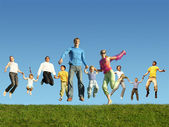 Many jumping families on the grass, collage — Stock Photo