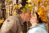 Old man and old woman in autumnal forest — Stock Photo