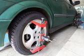 Green car on repair in car-care center — Stock Photo