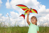 Little girl plays kite on meadow — Stock Photo