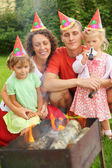 Happy family with children near brazier on picnic, happy birthda — Stok fotoğraf