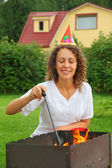 Young woman near in cap brazier on picnic, happy birthday — Stock Photo