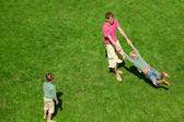 Boys play with the man outdoor. The Top view. — Stock Photo