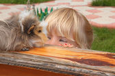Little girl looking on Guinea pig — Stock Photo