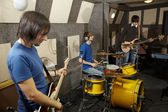 Rock band is working in studio — Stock Photo