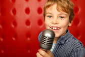 Boy with microphone — Stock Photo