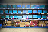 Rack with liquid crystal displays and monitors in electronics shop — Stock Photo