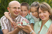 Wendy house in hands — Stock Photo
