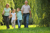 Family in early fall park — Stock Photo
