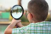 Through magnifier — Stock Photo