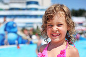Pretty little girl near pool in aquapark of an entertaining comp — Stock Photo