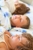 Children three together sleeping on bed in cosy room, lying on b — Stock Photo