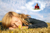 Young woman lies on the grass and boy in dream cloud collage — Stok fotoğraf