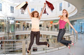 Jumping girls in business center, collage — Stock Photo