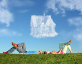 Lying couple on grass and dream house collage — Φωτογραφία Αρχείου
