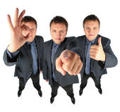 Three businessmen, two with ok gesture and one showing to you, c — Stock Photo