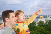 Father with son on historic centre of St.Petersburg background c — Stock Photo