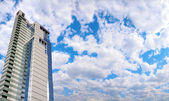 Office building and panorama of sky — Stock Photo