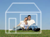 Family with son and house of dream — Stock Photo