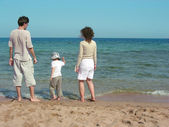 Familie zee zand — Stockfoto