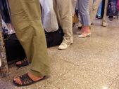 Legs luggage queue — Stock Photo