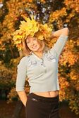 Blue-eyed blond with the yellow leaves — Stock Photo