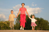 Mother walks with children — Stock Photo