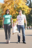 Family in the park in autumn 2 — Stock Photo
