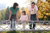 Family in the park at parapet — Stock Photo