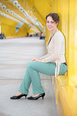 Young woman sitting on pedestrain bridge — Stock Photo