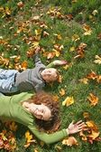 Woman with the son they lie on the grass — Stock Photo