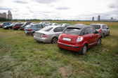 Cars on the meadow — Stock Photo