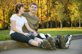 Young roller couple sit — Stock Photo