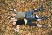 Young roller couple lies — Stock Photo