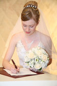 Bride sets signature — Stock Photo