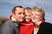 Grandmother and grandfather with the grandson — Stock Photo