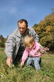 Grandfather with the granddaughter in the park — Stock Photo