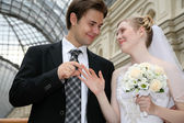 Fiance puts on ring to the bride — Stock Photo