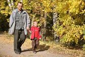 Grandfather with the grandson walk in park in autumn — Stock Photo
