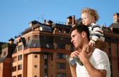 Child on the shoulders of the father — Stock Photo