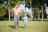 Grandfather with grandson run — Stock Photo