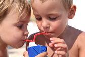Children drink juice. — Stock Photo